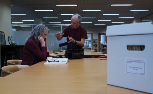 filmmaker speaking with special collections staffer