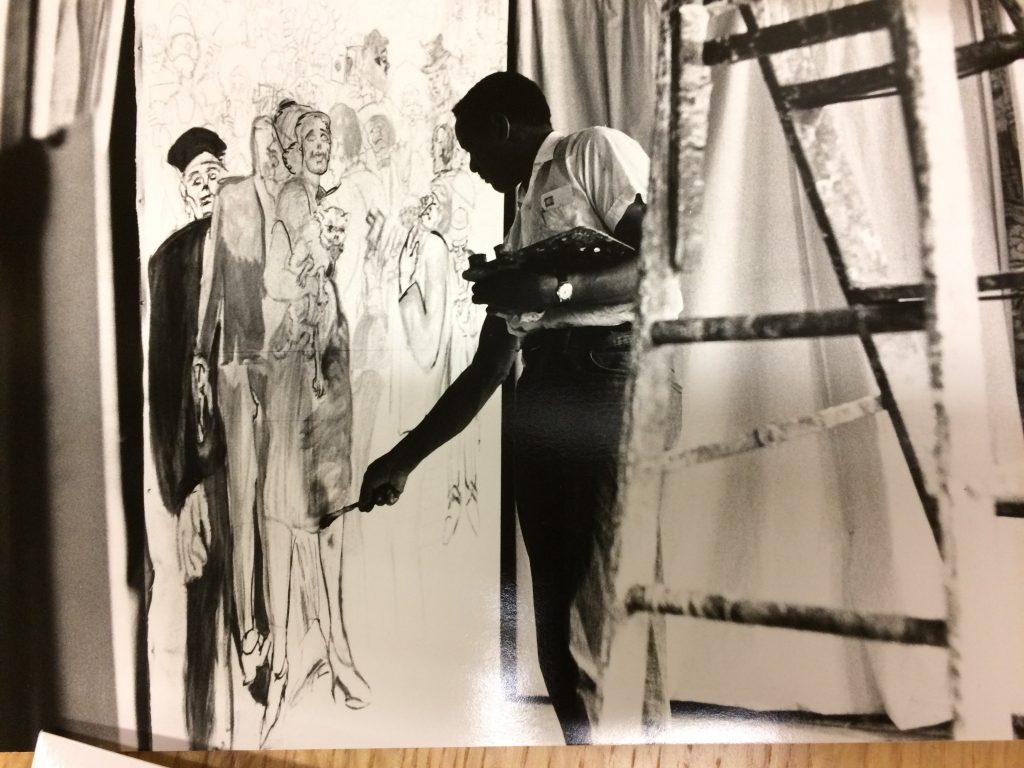 photograph of artist Joseph Delaney at work