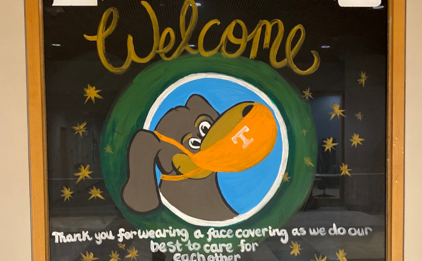 """Painted image of Smokey wearing a mask that reads """"Libraries Welcome, thank you for wearing a face covering"""""""
