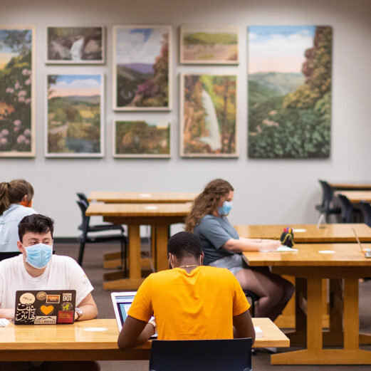 students in the miles reading room