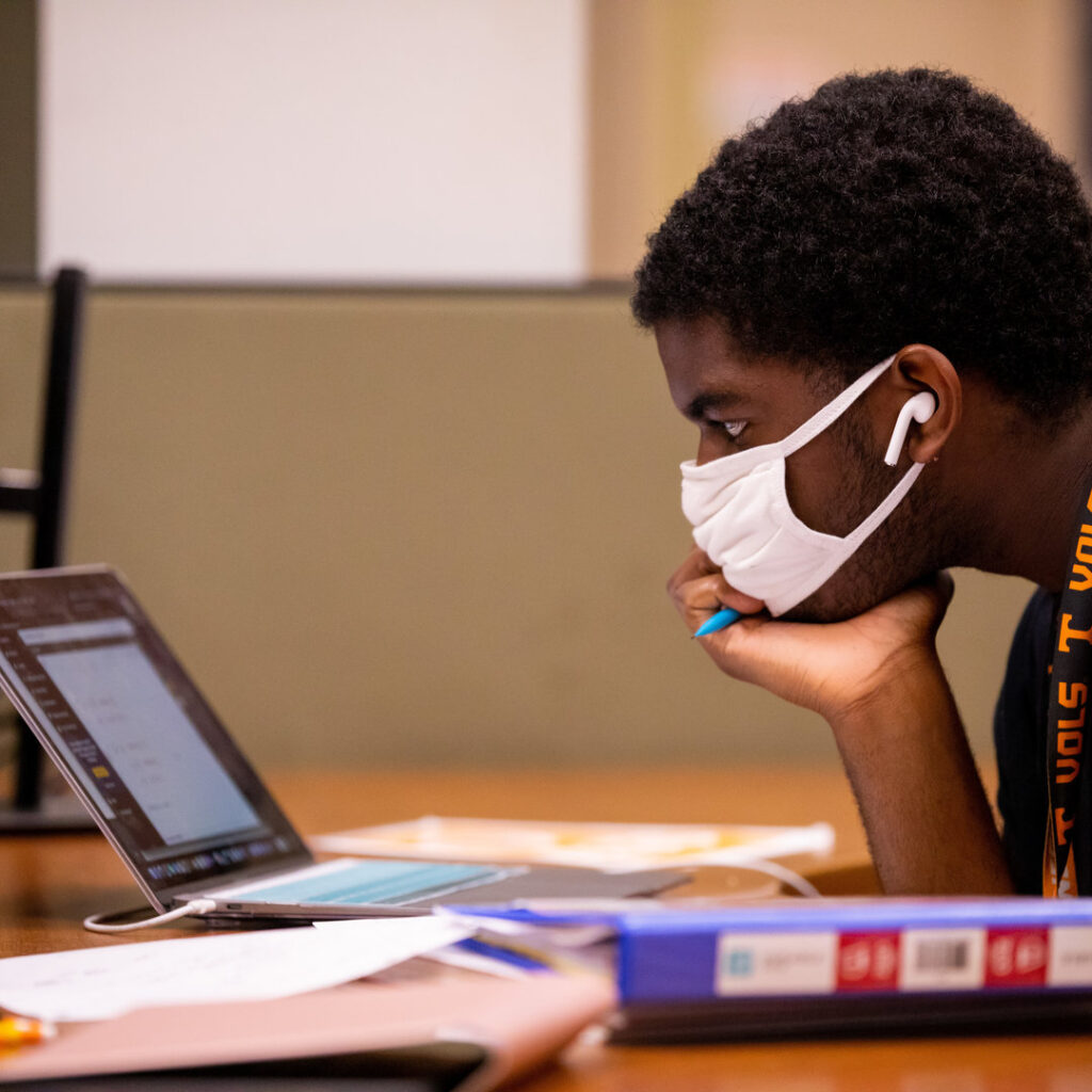 A graduate student learns about how UT Libraries can support their research
