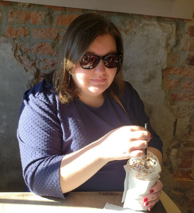 Image of Samantha Ward of Pendergrass Library, wearing sunglasses and holding coffee