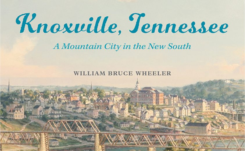 Cover image of Bruce Wheelers book, featuring a river, bridge, and buildings