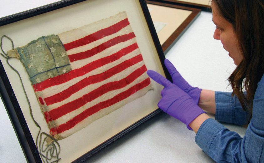 Photograph of an American flag in a case